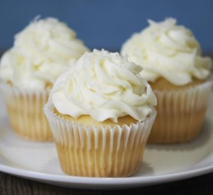 image on page for  Coconut Cupcake  / perceived to contain Cake, Cream, Creme, Dessert, Food, Icing, Cupcake, Butter, Custard, Bread, Muffin