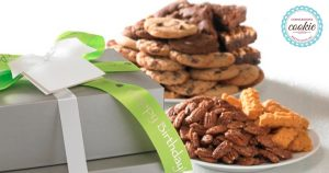 Image perceived to contain Flora, Food, Grain, Nut, Pecan, Plant, Produce, Seed, Vegetable, Snack, Computer, Electronics, Laptop, Pc, Peanut Butter, Furniture on the Sweeten Spring Planning - Cornerstone Cookie Gifts page
